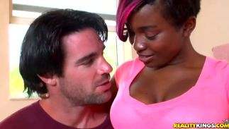 Alluring big boobed black lady Roxanne Shorte swallows fellow's huge dangler