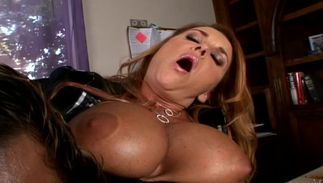 Sinful dark-haired Janet Mason with large tits sucks a large fat packing monster